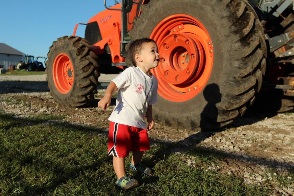 Silly farmkid by tractor