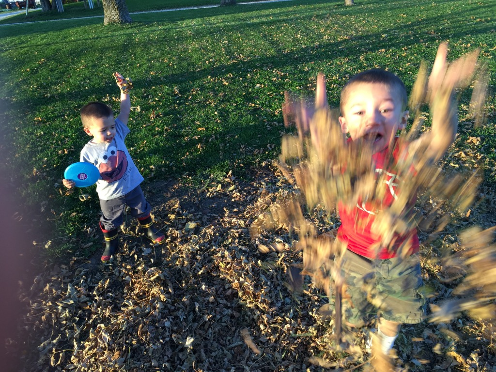 Kids playing in the fall leaves