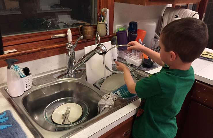 Hudson washing dishes