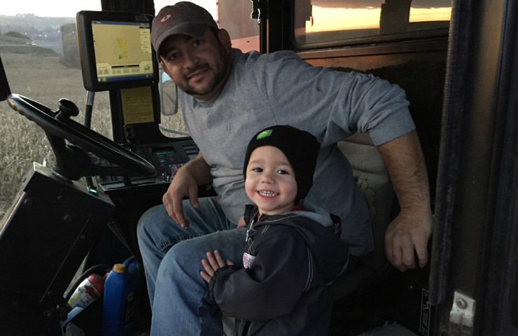 Son Riding in Combine with Daddy