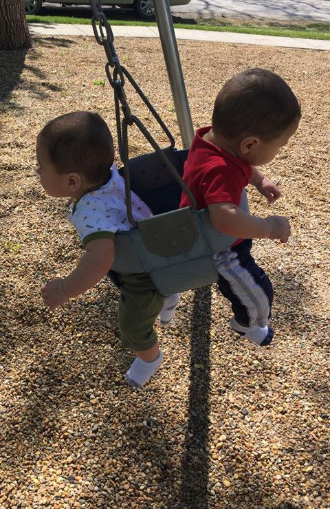 Twins swinging