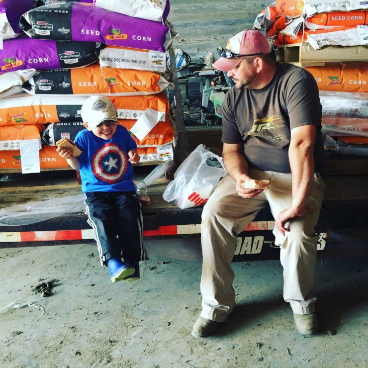 Axten and Daddy eating lunch during planting season at www.saras-house.com